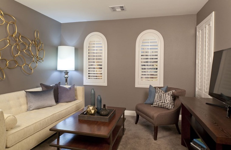 White shutters on arched windows in family room