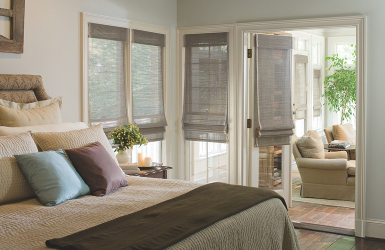 Contemporary bedroom with light woven shades