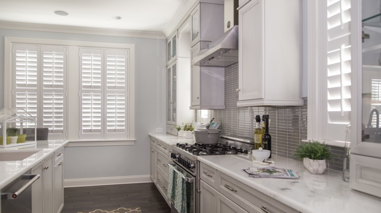 Polywood shutters in Chicago kitchen with white cabinets.