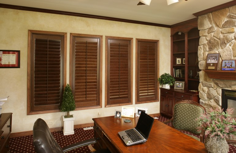 Wooden plantation shutters in a Chicago home office