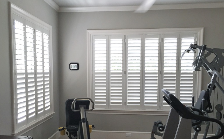 Chicago home gym with shuttered windows.