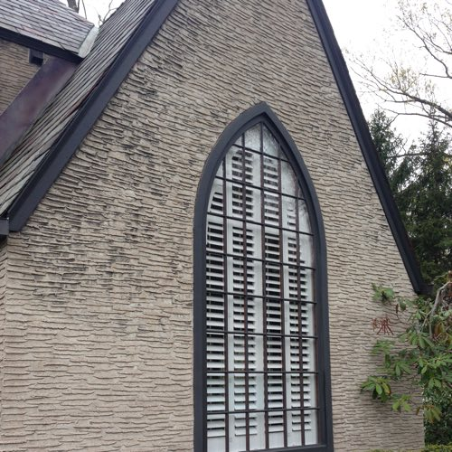 outside view of brick home with plantation shutters