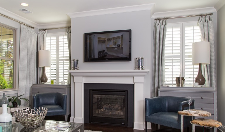 Chicago fireplace with white shutters.