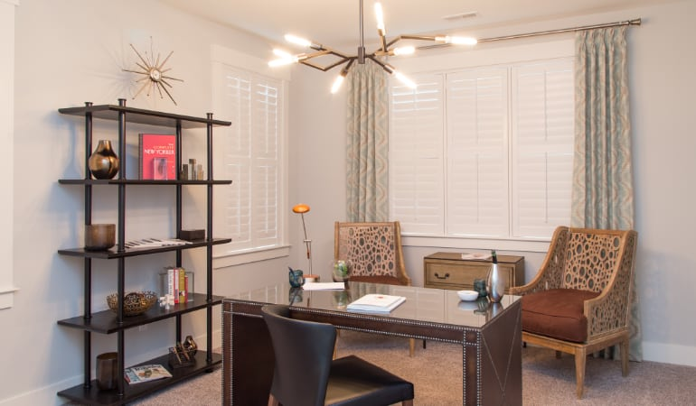 Chicago home office with plantation shutters.