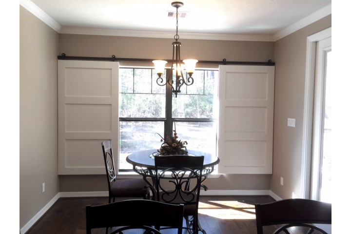 Chicago dining room with classic barn door shutters.