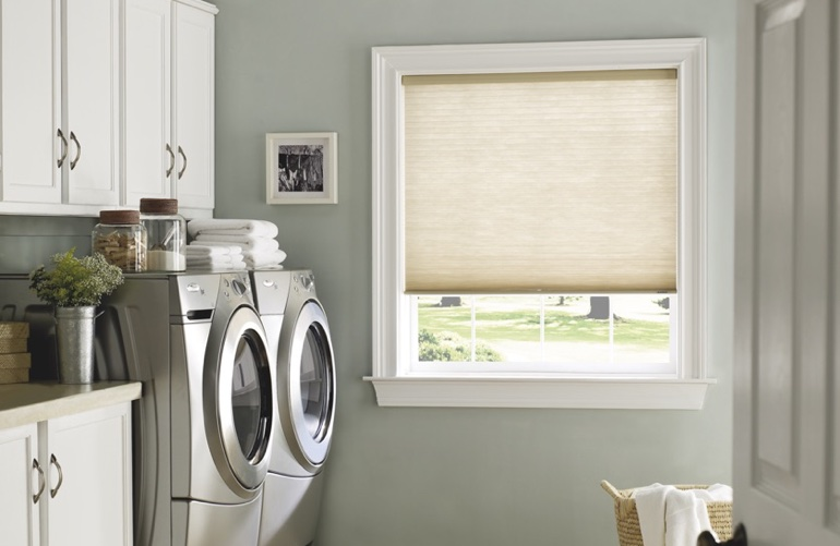Chicago laundry room with tan window shades.