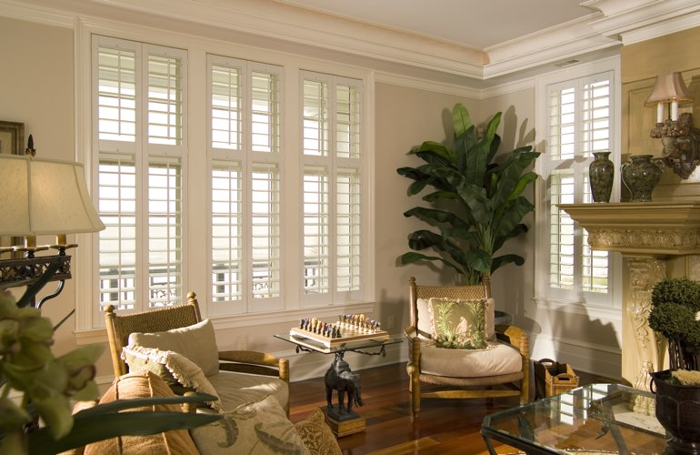 Living Room in Chicago with polywood plantation shutters.
