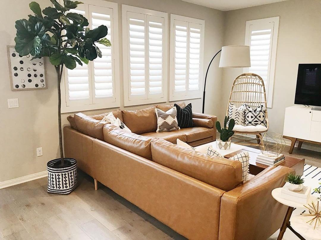 Warm living room with Polywood shutters in Chicago.