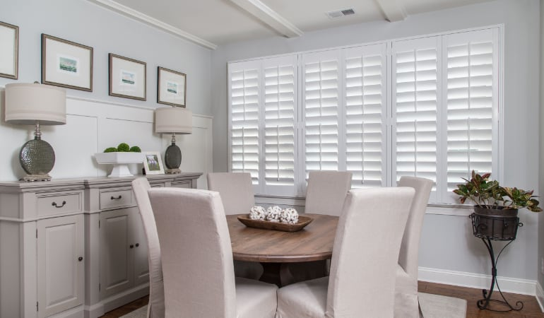 Plantation shutters in a Chicago dining room.