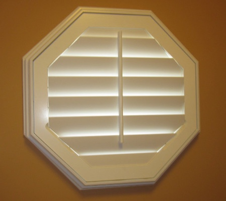 Chicago octagon window with white shutter