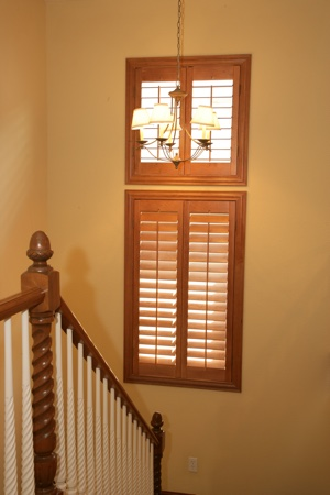 Wooden shutters in tan stairway.