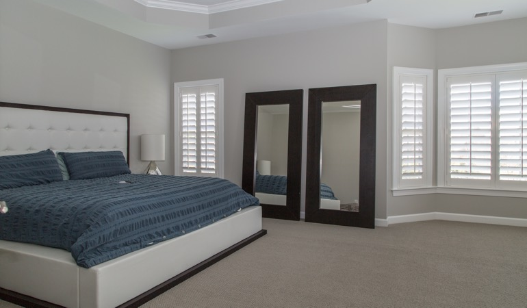 Polywood shutters in a minimalist bedroom in Chicago.