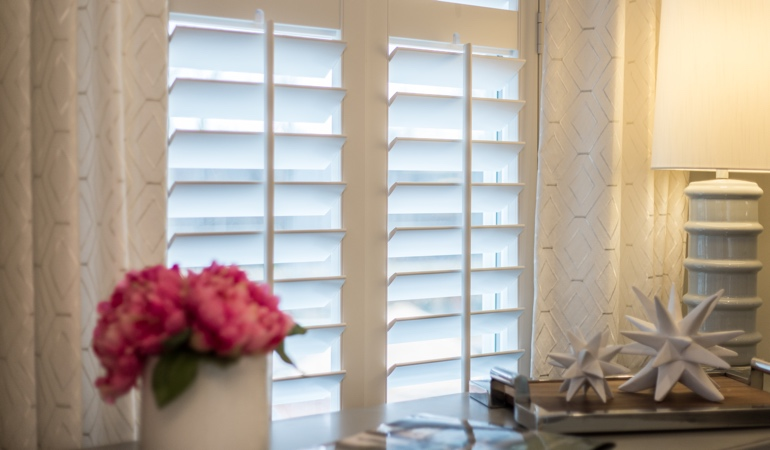 Plantation shutters by flowers in Chicago
