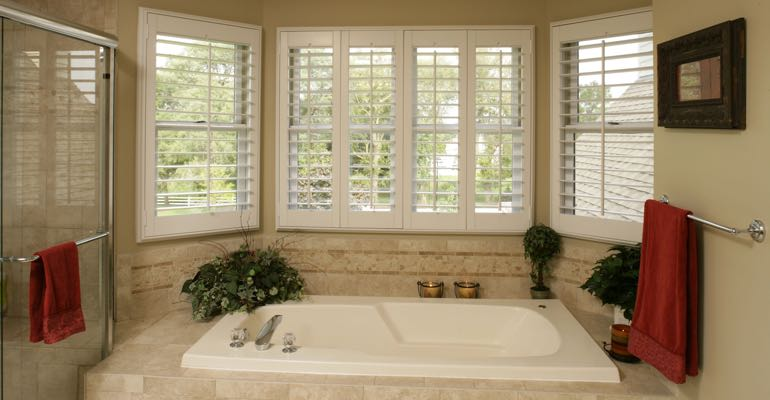 Plantation shutters in Chicago bathroom.