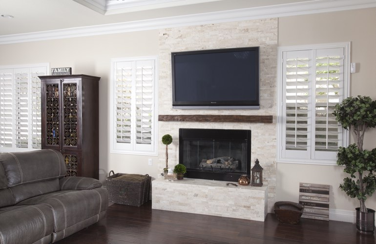 White plantation shutters in a Chicago living room with solid hardwood floors.