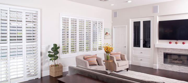 Chicago living room in white with plantation shutters.