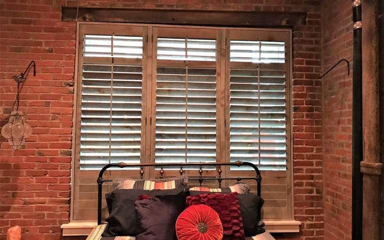 repurposed wood shutters in Chicago bedroom