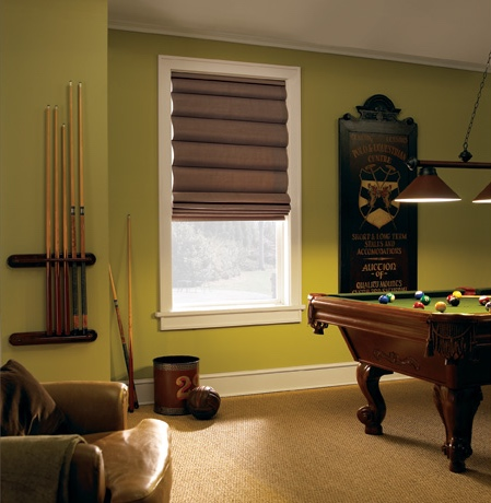 Roman shades in Chicago rec room with green walls.