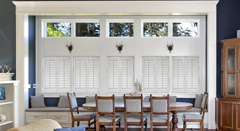 Chicago dining room with white plantation shutters.