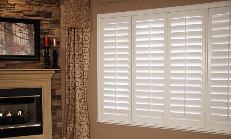 Chicago Studio plantation shutters in family room.