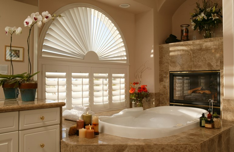 Semicircle shutters in a Chicago bathroom.