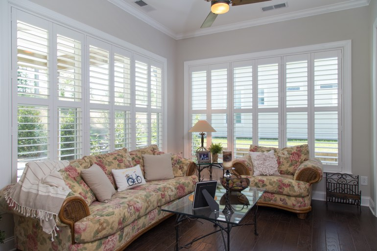 Airy sunroom with interior shutters in Chicago.