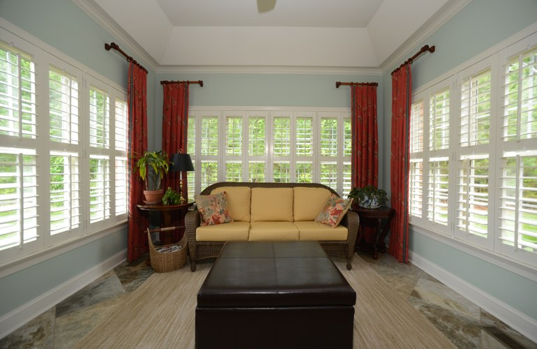 Chicago sunroom with plantation window shutters.