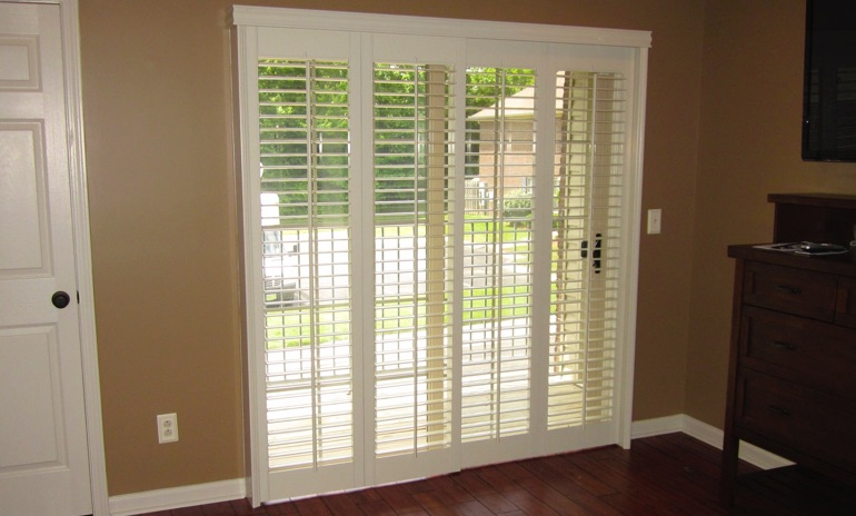 Chicago sliding door bifold shutters in den