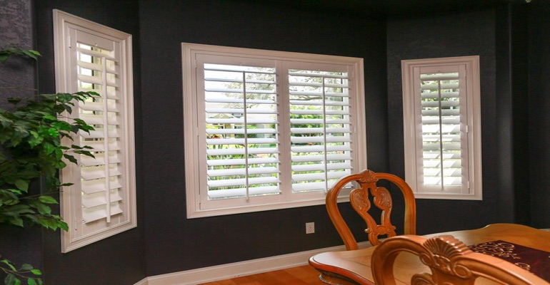 Crisp Polywood Shutters In Dining Room With Dark Paint