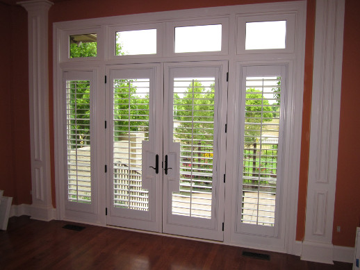 Chicago patio door with sidelight shutters