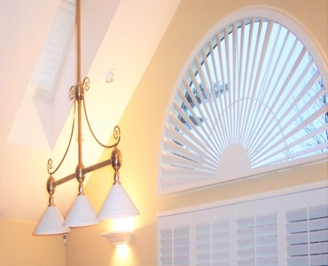 Chicago arched eyebrow window with plantation shutter