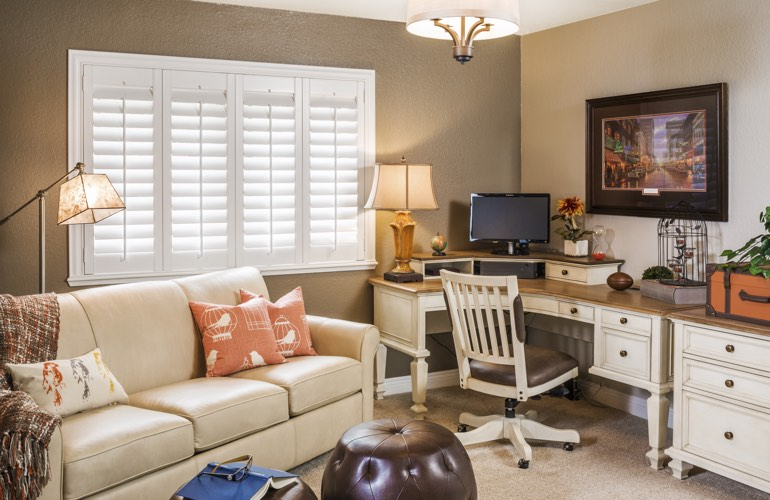 Chicago home office with plantation window shutters.