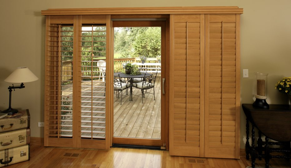 Bypass wood patio door shutters in Chicago living room