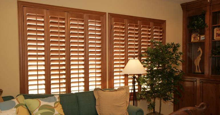 Natural wood shutters in Chicago living room.