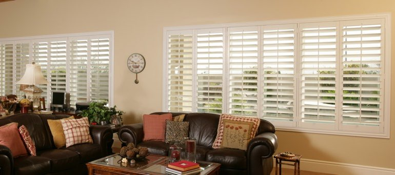Wide window with interior shutters in Chicago living room